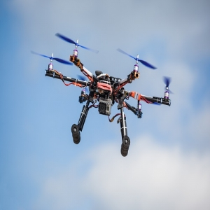 Flying drone with camera attachment