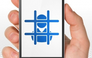Law concept: Hand Holding Smartphone with blue Criminal icon on display